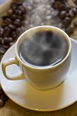 image of coffee crop  - Hot morning coffee with fresh roasted coffee beans - JPG