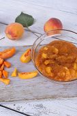 image of peach  - tasty peach jam with fresh peaches on wooden table - JPG