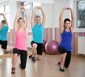 pic of pilates  - Image of people exercising in pilates class - JPG