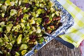 stock photo of brussels sprouts  - Grilled brussel sprout entree or side dish with nuts and cranberries healhy food - JPG