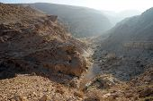 pic of ravines  - Ravine and mountain in Negev desert Israel - JPG