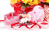 foto of fiance  - Colorful roses bride and fiance candle and gift box close up picture - JPG