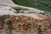 stock photo of landslide  - Bizarre rock formation exposed by small landslide - JPG