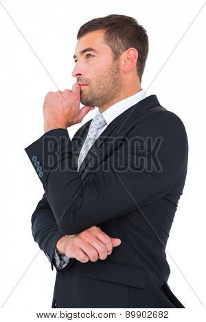 Frowning businessman thinking on white background