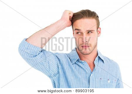 Handsome man in shirt thinking with hand on head on white background