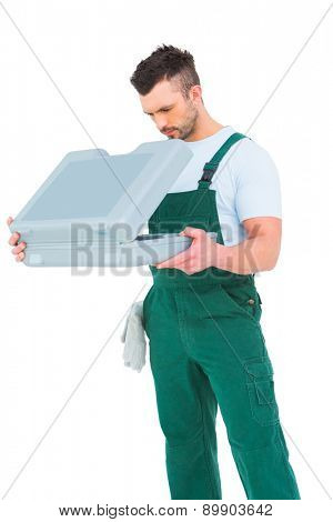 Repairman opening toolbox on white background