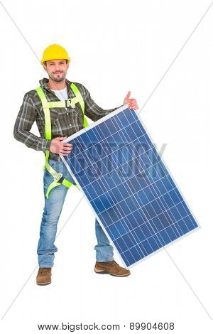 Smiling handyman with solar panel on white background