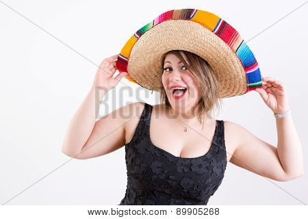 Happy Lady With Mexican Sombrero Looking At Camera