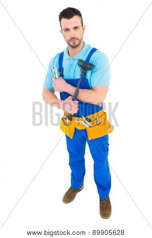 Plumber with plunger and tool belt on white background