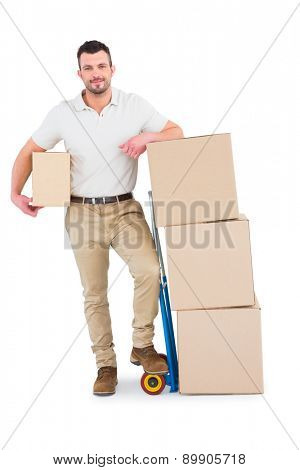 Delivery man with trolley of boxes on white background