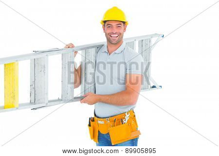 Portrait of smiling repairman carrying ladder on white background