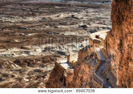 Ruins Of Masada With The Desert Of Depression Of The Dead Sea In The Background