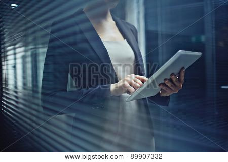 Close-up of businesswoman browsing with touchpad