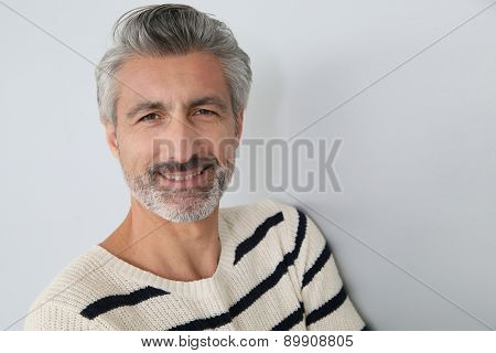 Portrait of handsome mature man on white background