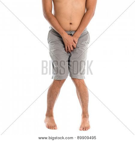 Asian man needing to urinate by covering his crotch with both hands, isolated on white background