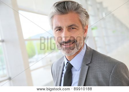 Businessman standing in building hallway