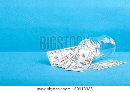 The Inverted Glass Jar With Dollar Bills, Side View