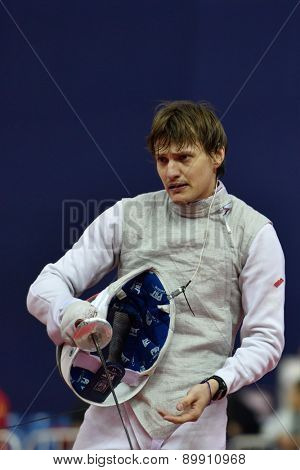 ST. PETERSBURG, RUSSIA - MAY 3, 2015: Alexey Cheremisinov of Russia in team quarterfinal of 41th International fencing tournament St. Petersburg Foil. The tournament is the stage of FIE World Cup