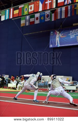 ST. PETERSBURG, RUSSIA - MAY 3, 2015: Alexey Cheremisinov of Russia vs Ryo Miyake of Japan in team quarterfinal of 41th International fencing tournament St. Petersburg Foil, the stage of FIE World Cup