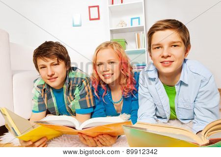 Happy young teens read books and smile
