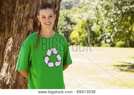 Environmental activist smiling at camera in the park on a sunny day
