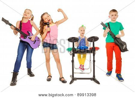 Four children perform together as rock group