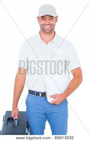 Portrait of confident male technician with toolbox and clipboard on white background