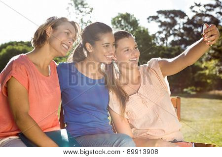 Students taking selfie outside on campus on a sunny day