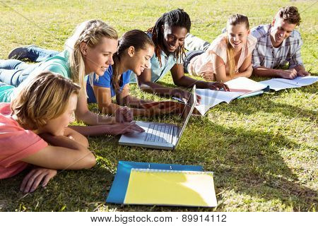 Students studying outside on campus on a sunny day
