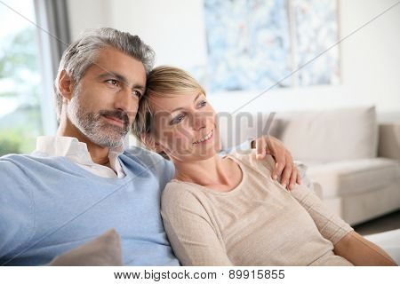 Loving mature couple looking towards the future