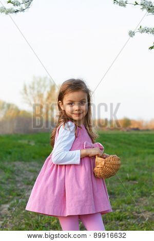 Adorable young girl holds colorful balloons