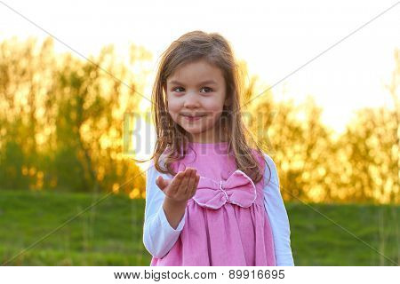 Adorable young girl with an open hand