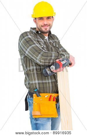 Carpenter holding power drill and wood plank on white background