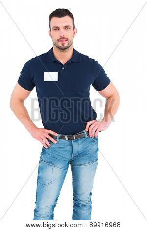 Male technician standing hands on hips on white background