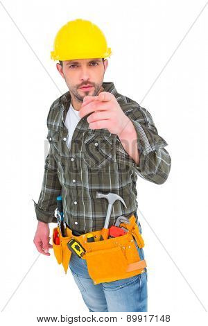 Handyman pointing at you on white background