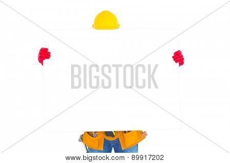 Handyman holding blank placard in front of face on white background