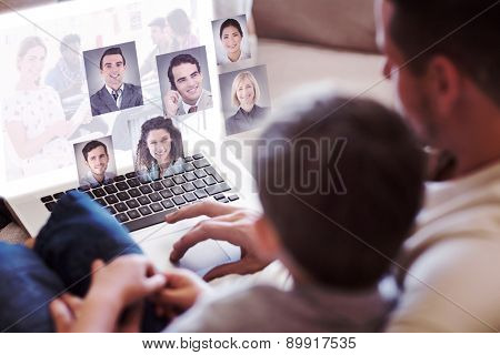 Editor holding tablet and smiling as team works behind her against profile pictures