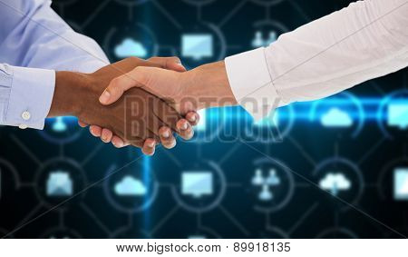 Close-up shot of a handshake in office against apps interface