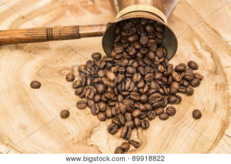 Coffee Pot With Coffee Beans On A Wooden Background