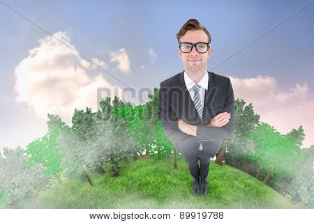 Geeky hipster smiling at camera against beautiful blue cloudy sky