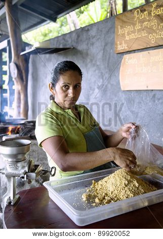 Woman prepares from corn flour tortillas