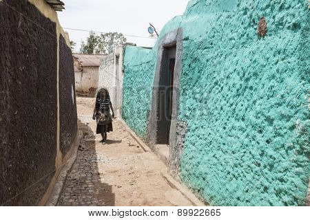 Harar, Ethiopia: April 17, 2015: Unidentified woman walks through the ancient city of Harar, Islam's fourth holiest city