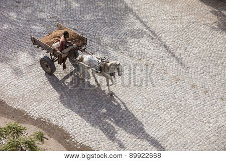 DIRE DAWA, ETHIOPIA-APRIL 17, 2015: Unidentified man drives horse drawn cart through the city of Dire Dawa, Ethiopia.