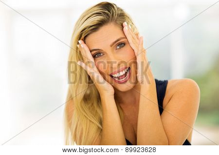pretty blonde woman laughing and looking at the camera