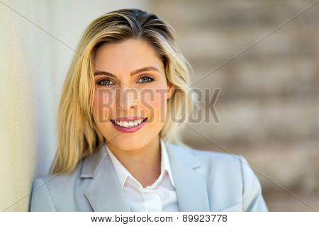 portrait of young career woman standing outdoors