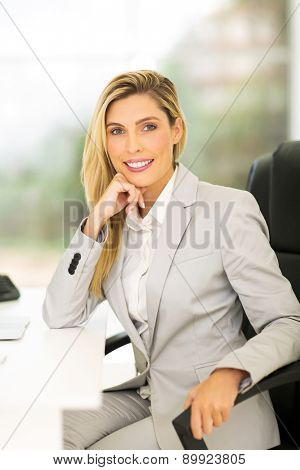 pretty female business executive in modern office