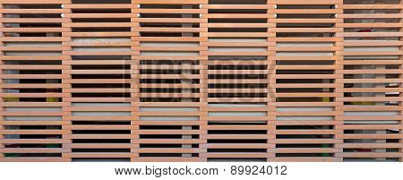 Pierced Wall Of Elongated Elements In Horizontal Rows As Background.