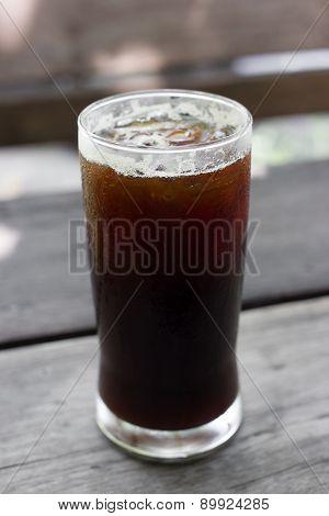 A Glass Of Black Iced Coffee.