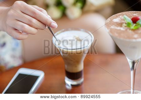 lifestyle of women using a mobile phone in cafe coffee shop