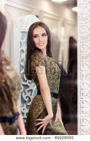 Beautiful Girl in Golden Brocade Dress Looking in the Mirror